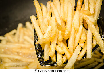 French fries in a hot pan.