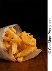 French fries in packet - French fries in rolled newspaper...