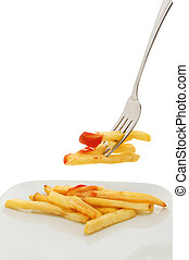 French fries on plate and fork