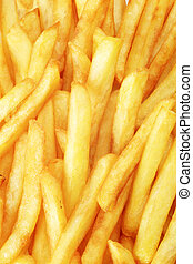 French fries  - Macro of tasty French fries - full frame