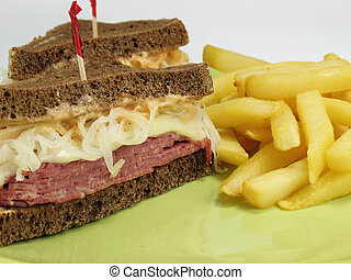 Reuben sandwich with corned beef, melted swiss cheese, sauerkraut, and thousand island dressing on pumpernickel rye bread. Served with french fries.
