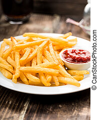 French fries - Fresh fried french fries with ketchup on...