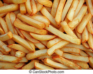 French fries - Close-up of oily French fries as a background