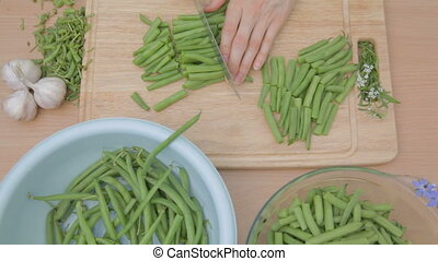 French green beans being cut with s