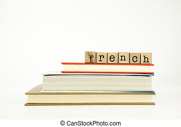 french language word on wood stamps and books - french word...
