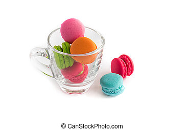 French macarons colorful on glass cup with white background, sweet and dessert menu, selective focus
