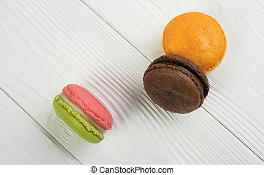 French macarons on white wooden background