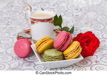 French macarons with coffee and flowers