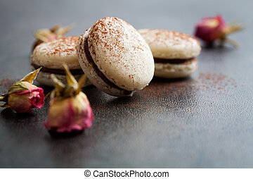 French macaroons with chocolate filling and cocoa powder