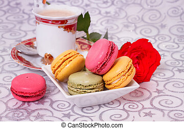 French macaroons with coffee and flowers