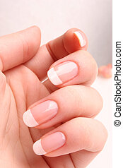 French manicure 01 - Woman's hand with French manicure