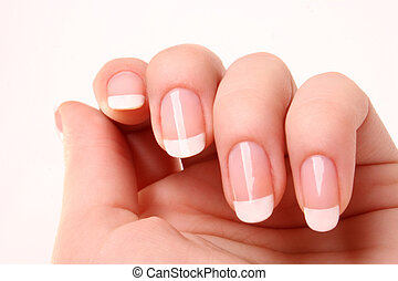 Woman's hand with French manicure