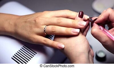 French manicure in beauty studio