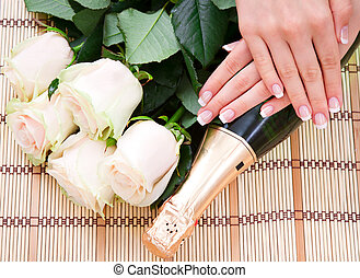 French manicure, white roses and champagne