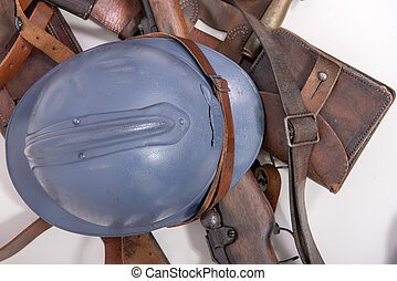 french military helmet of the First World War with rifle on white