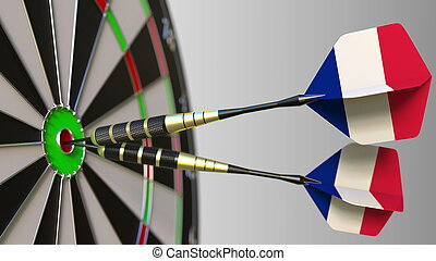 French national achievement. Flags of France on darts hitting bullseye. Conceptual 3D rendering