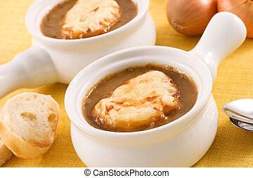 Two bowls of a classic french onion soup