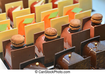 Chocolate cakes on display a confectionery shop in France.