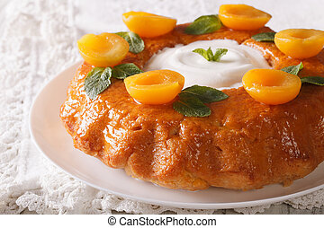 French pastries: Savarin with decorated apricots and mint...