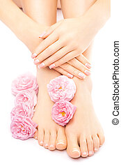 pedicure and manicure with a pink rose flower