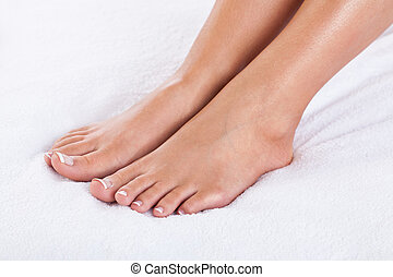 French pedicure - Close-up of female feet with french ...