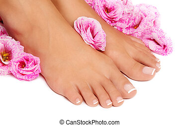 French pedicure - Close-up shot of woman tanned feet with...