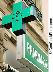 French pharmacy sign and word in the street