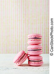 French pink macarons on white wooden background