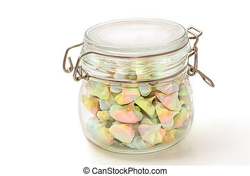 French rainbow meringue cookies in glass bowl on white background