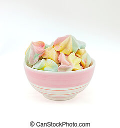French rainbow meringue cookies on white background with copy space. Macro with shallow dof.