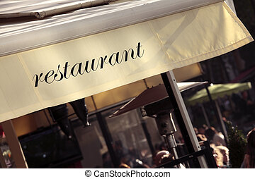 French restaurant, Paris france, tables, chairs, customers...