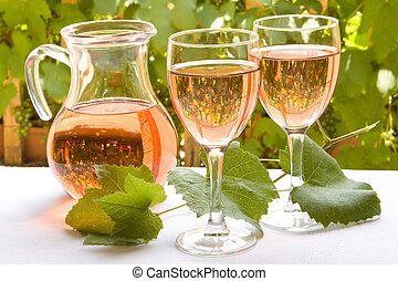 French rose wine - Two glasses of french rose wine against a...