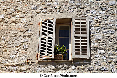 french rustic window with old wood shutters in stone rural ...