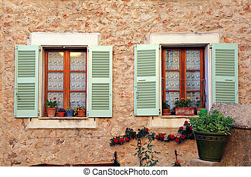 french rustic windows with old green shutters, Provence -...