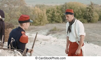 French soldier gives instructions to another before shooting...
