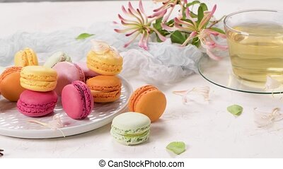 A french sweet delicacy, macaroons variety closeup. Color fresh macaroons on wooden background.