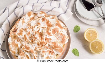 French tart with Merengue on white wooden background. Pastry...