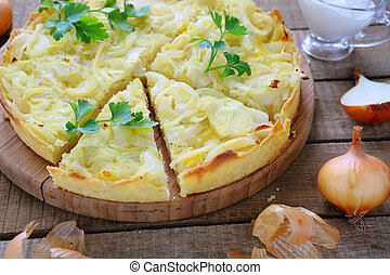 French tart with onions and cheese, food closeup