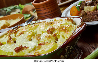 Tartiflette. Traditional assorted French dishes Top view. made with potatoes reblochon cheese lardons and onions