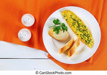 French tender omelette on white plate
