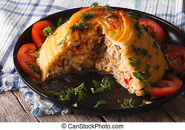 French timbale of pasta stuffed with chicken and vegetables close up