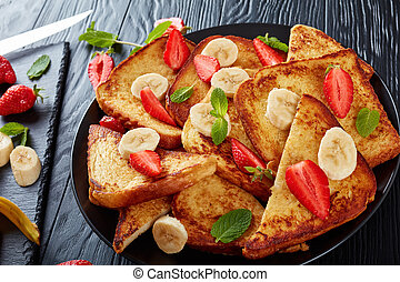 french toasts on a black plate