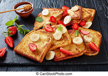 French toasts with fruits, top view