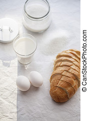 French tost ingredients: wheet bread, eggs, milk, sugar
