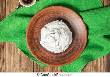 French vanilla meringue cookies on wooden background.