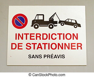 Close up on french vehicles towing sign on a wall
