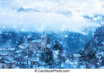 French village in snow, old church cloud covered