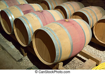 french winery with   barrels in rows
