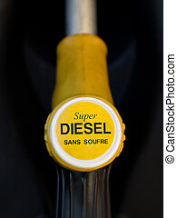 French yellow super diesel pump closeup with black...