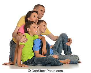 Frendly family on the floor on white background